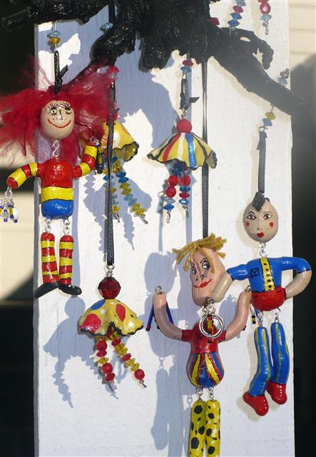Little Dancing People. Clay and wood mobile. Showing at Arts Alive starting July 21st 2012.